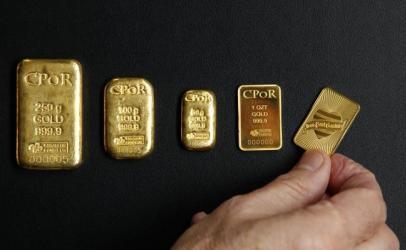Oro cae ante fortalecimiento del dólar