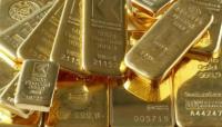 Oro sube por debilidad del dólar, pero alza de acciones contienen ganancias
